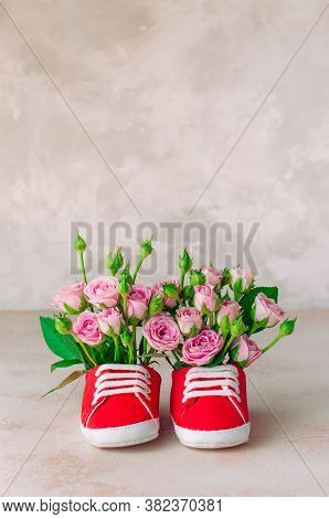 Pair Of Red Baby Shoes With Rose Flowers
