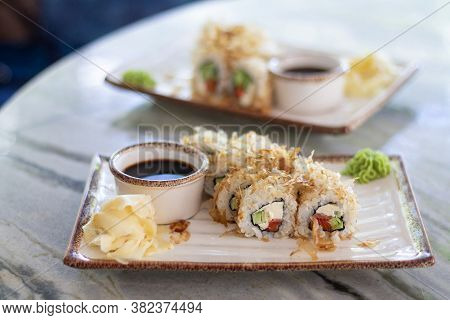 Set Of Sushi Bonito Rolls With Salmon, Cheese And Smoked Tuna Flakes. Traditional Japanese Food