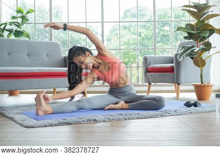 Exercises At Home Concept. Young Asian Woman Doing Body Stretching Before Training.