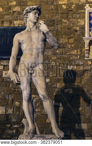 Nightshoot Portrait Of David Sculpture And Shadow In City Square In Florence