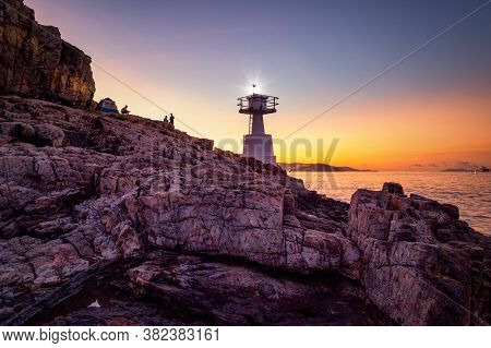 Mount Johnston Lighthouse At Ap Lei Pai Beaming Light Ray In Marine At Night