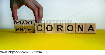Hand Turns Cubes And Changes The Expression 'pre Corona' To 'post Corona'. Covid-19 Pandemic Concept