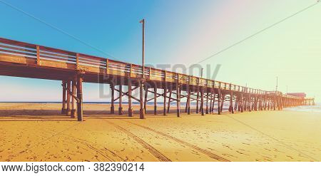 Wooden Pier In Newport Beach At Sunset. Orange County, Southern California. Vintage Tone Effect