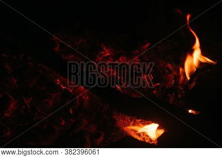 Ashes And Coals, Smoke From The Fire. Sparks From The Fire And Red-hot Coals On A Black Background C