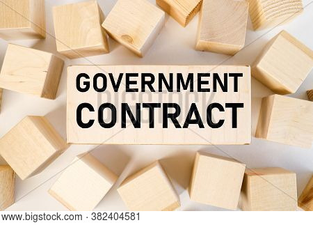 Government Contract. Text On Wooden Board Near Wooden Cubesbuy Or Rent Text On A Wooden Board On A R