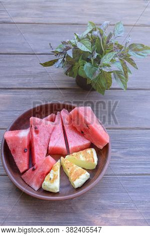 Delicious Summer Snack. Grilled Salty Levantine Halloumi Cheese And Slices Of Sweet Watermelon On A