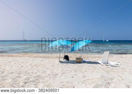Lonely Beach Umbrellas On White Sand Of The Beautiful Beach (ses Salines) On The Ibiza Island, Balea