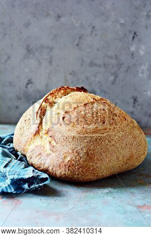 Homemade Freshly Baked Country Bread  Made From Wheat And Whole Grain Flour On A Gray Background. Fr