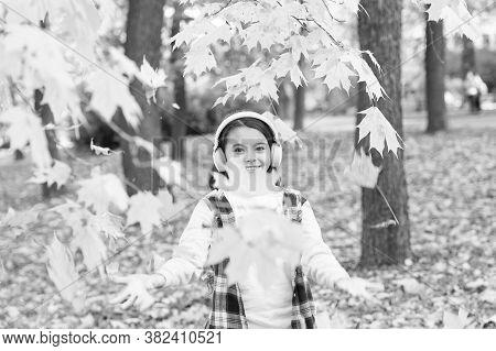 Melody Of Autumn. Small Kid Listening Modern Headphones. Headphones Technology. Falling Leaves. Happ