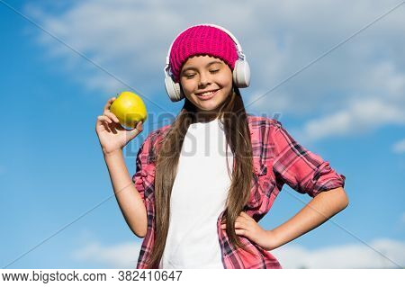 Organic Food Offers More Nutrients. Happy Child Hold Apple On Sunny Blue Sky. Fruit Snack. Organic N