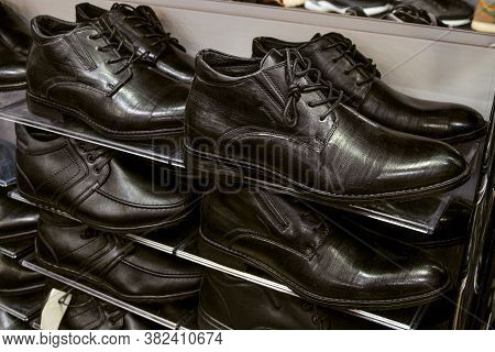 Multi-storey Shelve With Rows Of Black Man Off-season Shoes