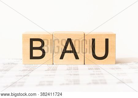 Business Acronym Bau - Business As Usual. Wooden Small Cubes With Letters Isolated On White Backgrou