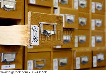 Library Catalogue Cards In Old Wooden Box. File Archive, Opened Drawer With Paper Documents, Databas