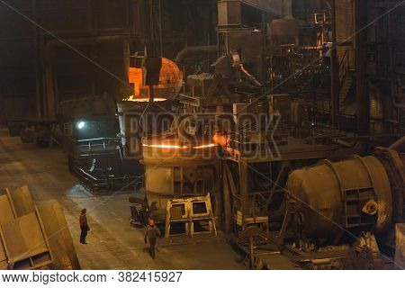 Melting Of Metal In A Steel Plant. High Temperature In The Melting Furnace. Metallurgical Industry.