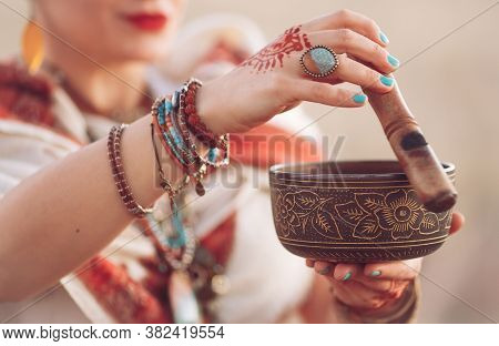 Concept. Woman Playing A Tibetan Bowl. Pregnant Woman Doing Yoga In The Field At Sunset