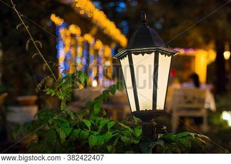 Iron Retro Lantern Of Street Lighting Glowe With Warm Light In The Night Garden Of The Backyard Clos