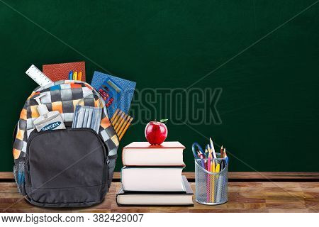 Education Back-to-school Concept In The New Normal Classroom Setting Showing Backpack Stuffed With S