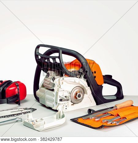 Concept Repair  Chainsaw And Gasoline Powered Tools. Chainsaw And Tools At Workbench .