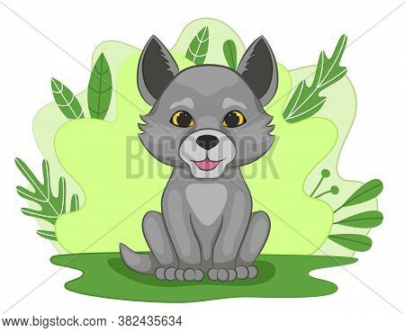 Cute Little Wolf Cub On Green Forest Glade. Pup On The Background Of Foliage And Plants. Cartoon Sty