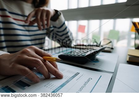 Business Woman Working In Finance And Accounting Analyze Financial Budget With Calculator In The Off