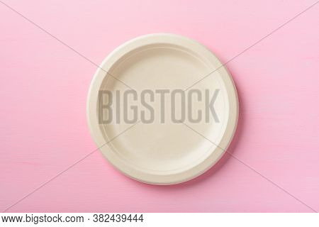 Biodegradable Plate, Compostable Plate Or Eco Friendly Disposable Plate On Pink Background