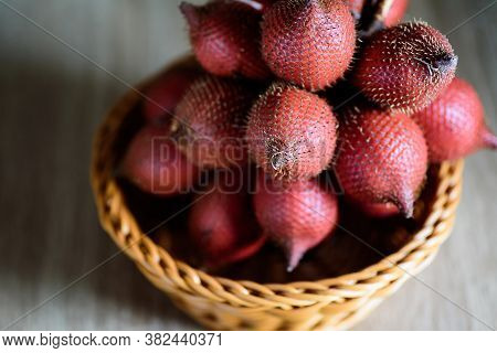 Red Salacca Fruit In Basket, Palm Fruit Native In Southeast Asia
