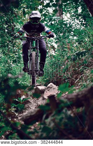 Russia, Moscow - August 26, 2020: Professional Cyclist Down Hill Riding. Biker Riding In Nature. Coo
