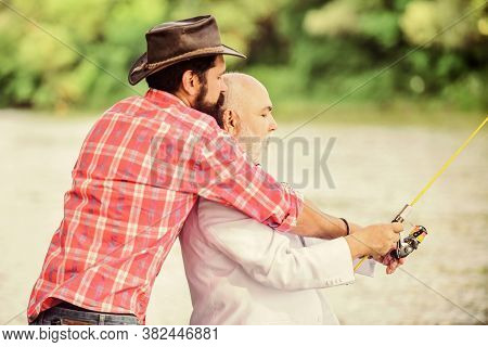 Bearded Man And Elegant Businessman Fish Together. Learn To Fish. Fishing Skills. Men Friends Relaxi