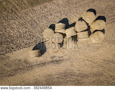 Aerial View Of Hay Bales In Summer. Top View Of Hay Stacks. Agriculture. Field After Harvest With Ha