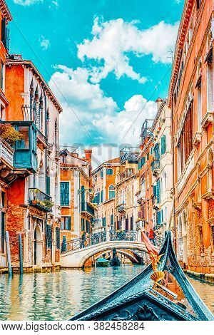 Views Of The Most Beautiful Channels Of Venice, Front Of The Boat The Gondola, Floating Along The Ca
