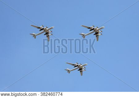 Moscow, Russia - June 20, 2020: A Group Of Tu-95ms Turboprop Strategic Bombers In The Sky Over Mosco