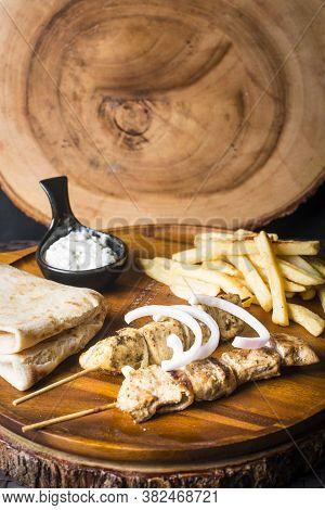 Souvlaki Kalamak Served With Pita And French Fries And Tzatziki