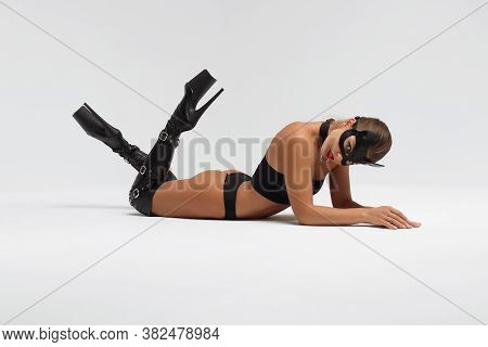 Full Body Side View Of Alluring Slim Tanned Brunette In Black Mask And Underwear With High Heeled Le