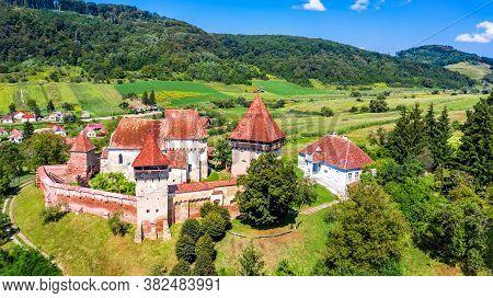 Alma Vii, Transylvania In Romania. Village And Fortified Church Saxon Landmark In Eastern Europe.