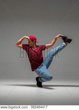Cool Guy Breakdancer Dancing Lower Break Dance Isolated On Gray Background. Break Dance Lessons