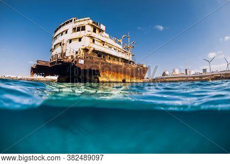 Telamon Wreck Ship In Blue Ocean Near Coasline. Arrecife, Lanzarote
