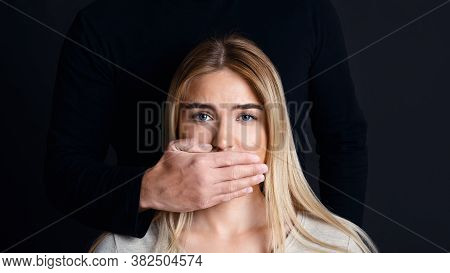 Shut Up And Listen. Male Hand Closes Woman Mouth And Prevents Her From Talking About Feelings And Do