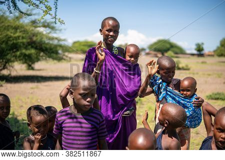 Engare Sero. Tanzania - January 2020: Indigenous Maasai In Traditional Village. Maasailand Is The Ar