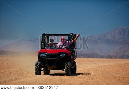 Driving A Buggy Car Through The Desert. Thrill Safari Adventures