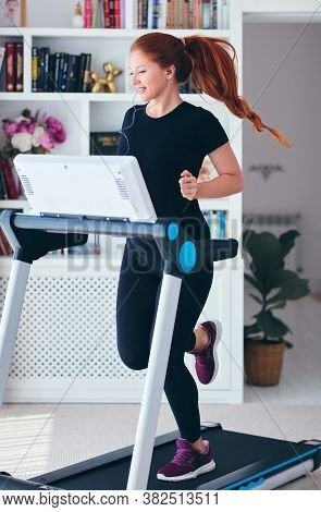 Happy Woman Exercising On A Treadmill At Home, Healthy Lifestyle