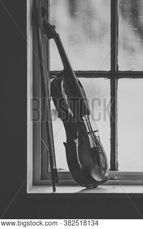 A Violin In A Wooden Window, Photo Of A Violin Near A Wooden Window