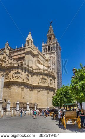 Sevilla, Spain - May 14, 2019: Horse Carriages In Front Of The Cathedral Of Sevilla, Spain