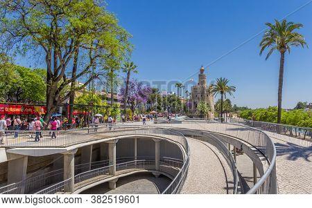 Sevilla, Spain - May 14, 2019: Golden Tower At The Riverbank In Sevilla, Spain