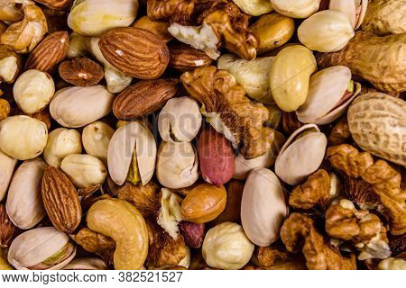 Background Of Various Nuts (almond, Cashew, Hazelnut, Pistachio, Walnut). Vegetarian Meal. Healthy E