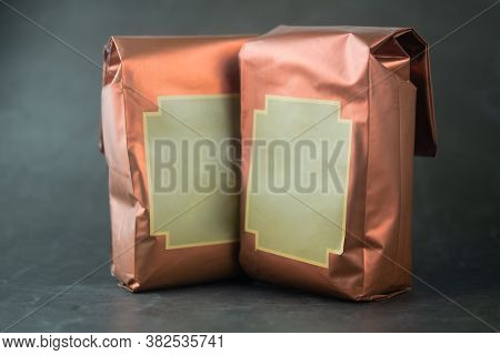 Aluminium Foil Copper Color Bags For Cocoa Powder Or Coffee Beans On Black Background