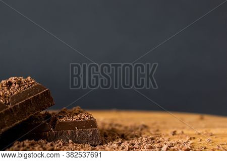 Chocolate Pieces Sprinkled With Chocolate Chips With Copy Space, Close Up