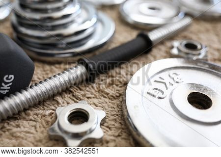 Carpet Apartment Are Disassembled Metal Dumbbells. An Effective Home-based Strength Training Program