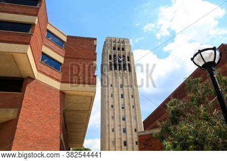 ANN ARBOR, MI - AUGUST 09,2020:  Burton Memorial clock tower on the campus of the University of Michigan,The tower was built in 1936 as a memorial for University President Marion Leroy Burton.