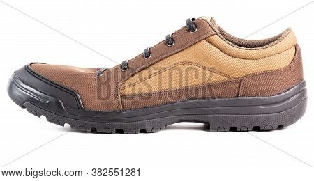 One Cheap Brown Fabric Hiking Or Hunting Shoe With Elastic Rubber Laces Isolated On White Background