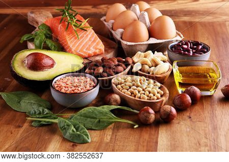 Selection Of Healthy Food For Heart, Life Concept With Eggs And Avocado On Background